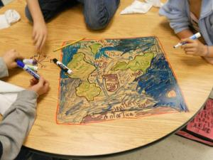 kids drawing map on table